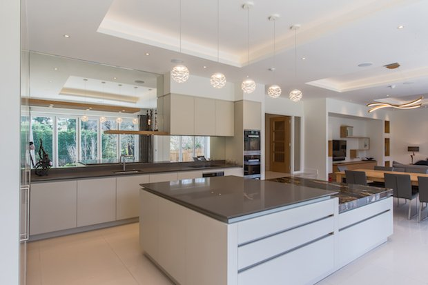 Roundhouse Urbo matt lacquer bespoke kitchen in Farrow & Ball Shaded White.jpg