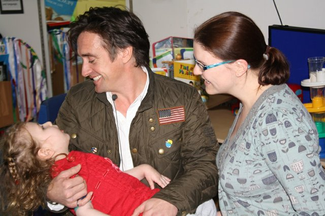 Richard meeting a little girl who is receiving rehabilitation for a brain injury, pictured here with her mum.jpg
