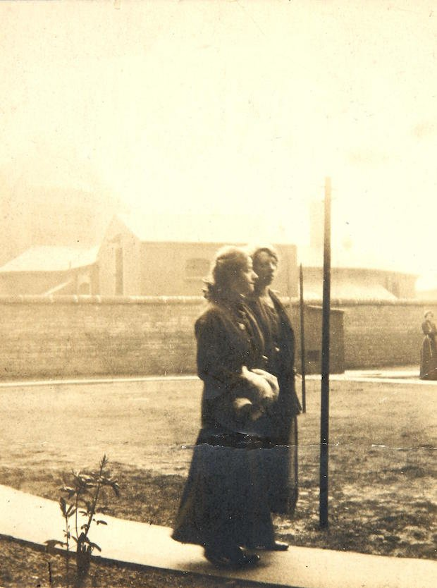 Suffragettes Evelyn Manesta and Lillian Forrester in prison yard