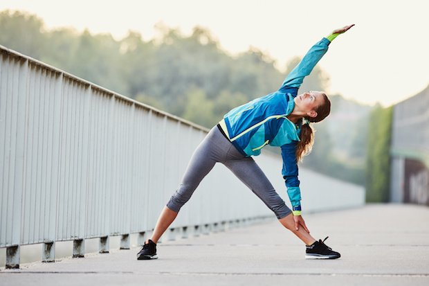 Woman doing yoga exercise at morning during running break