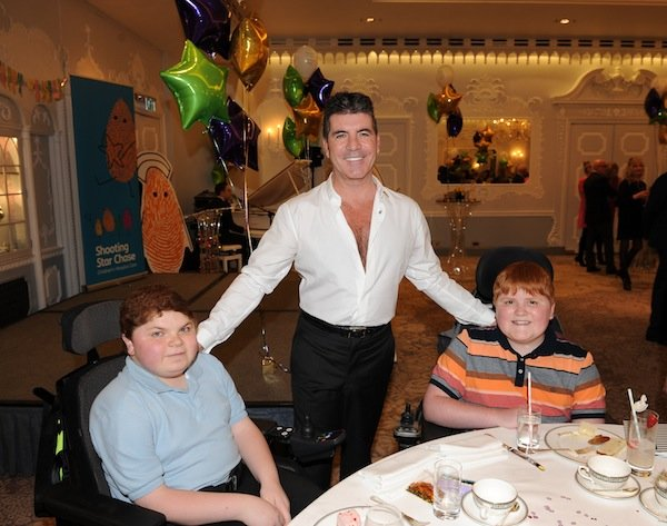 Simon Cowell with Cameron and Jordan
