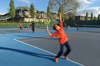 player-serving-select-tennis-academy-summer-camps-min.jpg