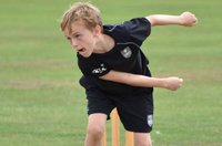 twenty20-cricket-child-bowling-for-summer-holiday-camp-epsom.jpg