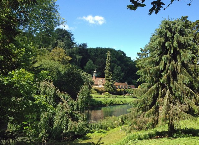 busbridge-lakes-wedding-reception-event-venue-gardens-in-surrey-canal-lake-view-to-coach-house.jpg