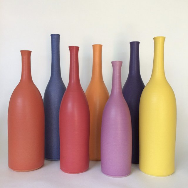 LucyBurley_7 bottles in floral tones_ wheelthrown white earthenware, max. height 29cm.jpg