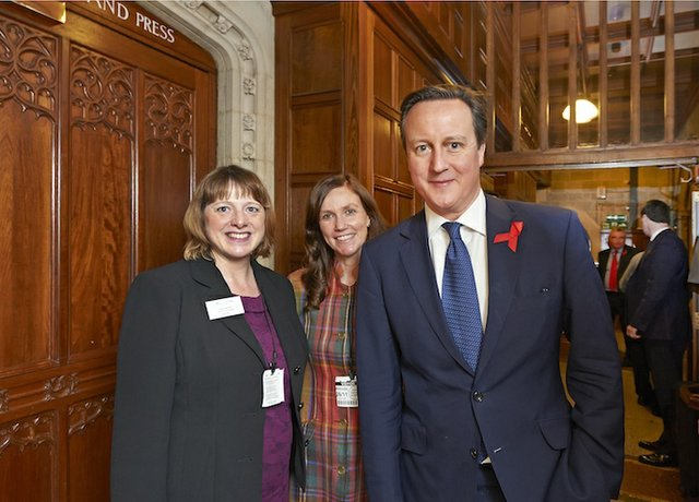 L-R Tracy Carroll of Local Food Surrey, Christine Howard of Visit Surrey welcome the Prime Minister to the Taste of Surrey event at the Houses of Parliament 26 November 2014[1].jpg