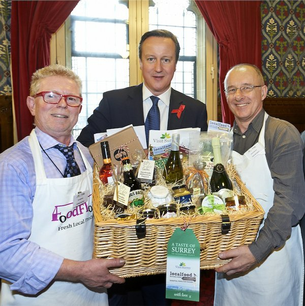 Food Float's Tim McEntire and Chris Robinson from Chalk Hills Bakery present the Prime Minister with the Local Food Surrey hamper.jpg