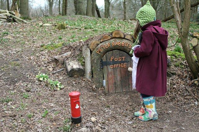Limpsfield-wooden-houses- little girl.jpg