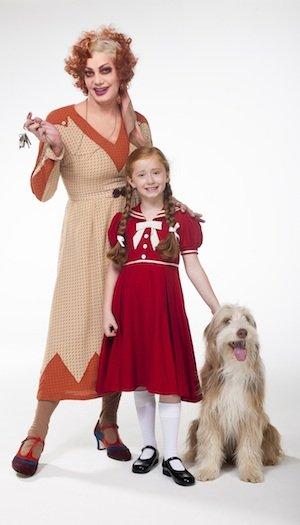 ANNIE - Craig Revel Horwood as Miss Hannigan with Annie and Sandy - Photo credit Hugo Glendinning.jpg