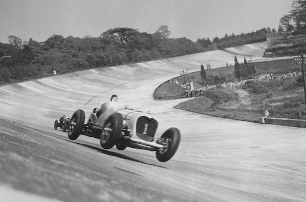 John Cobb in the 24 litre Napier-Railton taking the 'bump' on the Members' Banking. 1935. webcopy.jpeg