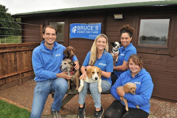 Bruce's Doggy Day Care - MD Bruce Casalis and some of the team copy.jpg