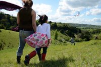Family flying a kite at Box Hill, Surrey.